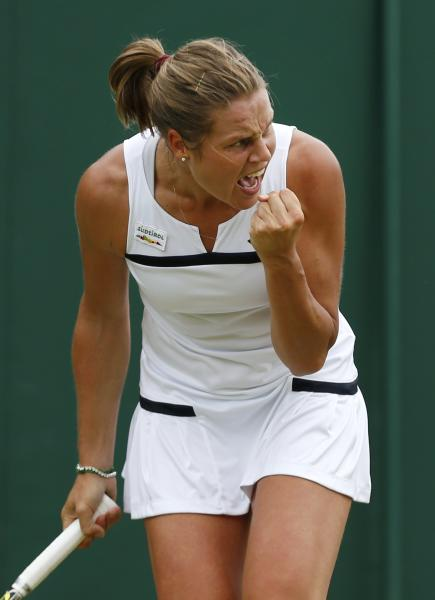 Karin Knapp of Italy reacts as she plays Michelle Larcher De Brito of Portugal during their Women's singles match at the All England Lawn Tennis Championships in Wimbledon, London, Friday, June 28, 2013. (AP Photo/Sang Tan)