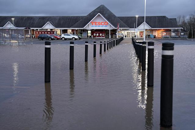 A flooded Tesco supermarket car park in Carlisle in the aftermath of Storm Ciara. (PA)