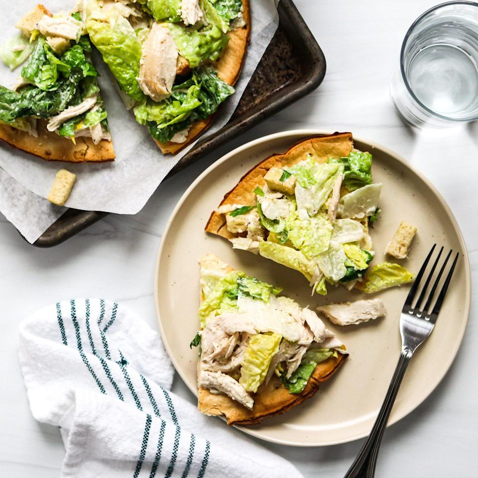 <p>A frozen cauliflower-based pizza crust becomes the crispy base for this no-fuss flatbread. Pick up a Caesar-style salad kit to save yourself the hassle of needing to buy lots of other ingredients (everything's included in the kit!), and use rotisserie chicken to simplify prep even more.</p>