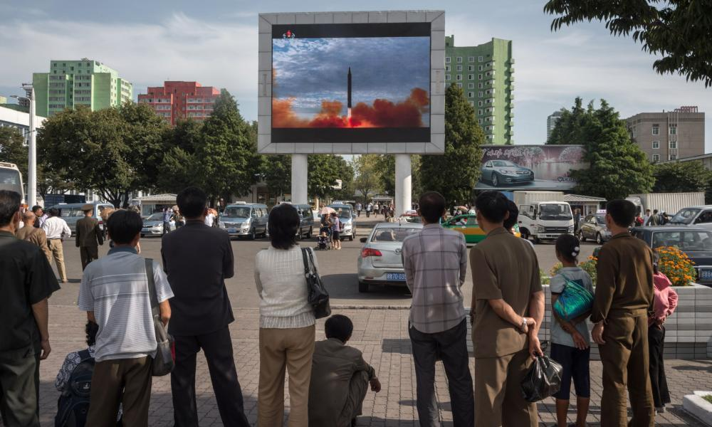 "<span class=""element-image__caption"">People watch as a screen shows footage of the launch of a Hwasong-12 rocket in Pyongyang on Saturday.</span> <span class=""element-image__credit"">Photograph: Kim Won-Jin/AFP/Getty Images</span>"