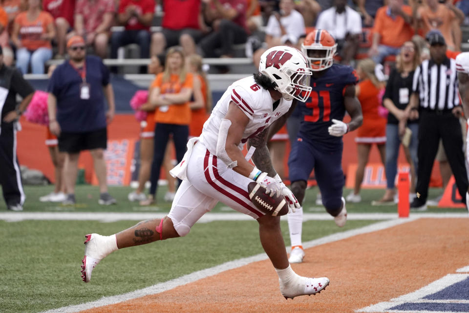 Wisconsin running back Chez Mellusi scores during the second half of an NCAA college football game against Illinois Saturday, Oct. 9, 2021, in Champaign, Ill. Wisconsin won 24-0. (AP Photo/Charles Rex Arbogast)