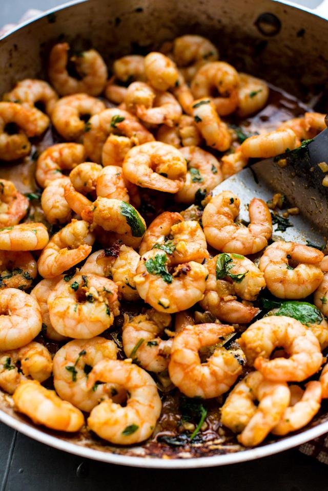 """<p>Dinner has never been easier! This slightly spicy and madly flavorful garlic cilantro shrimp comes together in minutes.</p><p>Get the recipe from <a href=""""http://www.delish.com/cooking/recipe-ideas/recipes/a53446/garlic-cilantro-shrimp-recipe/"""" rel=""""nofollow noopener"""" target=""""_blank"""" data-ylk=""""slk:Delish"""" class=""""link rapid-noclick-resp"""">Delish</a>.</p>"""
