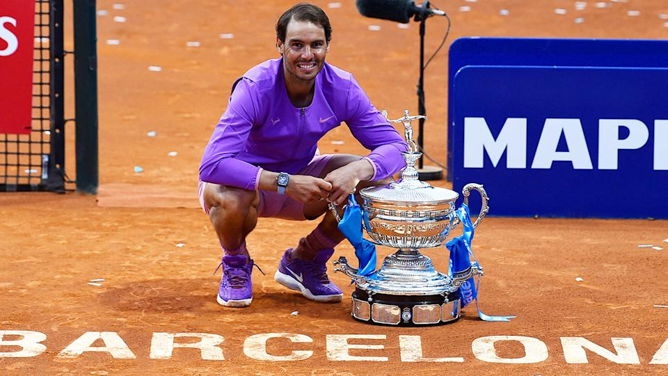 Rafael Nadal, pictured here posing with the trophy after winning the Barcelona Open.