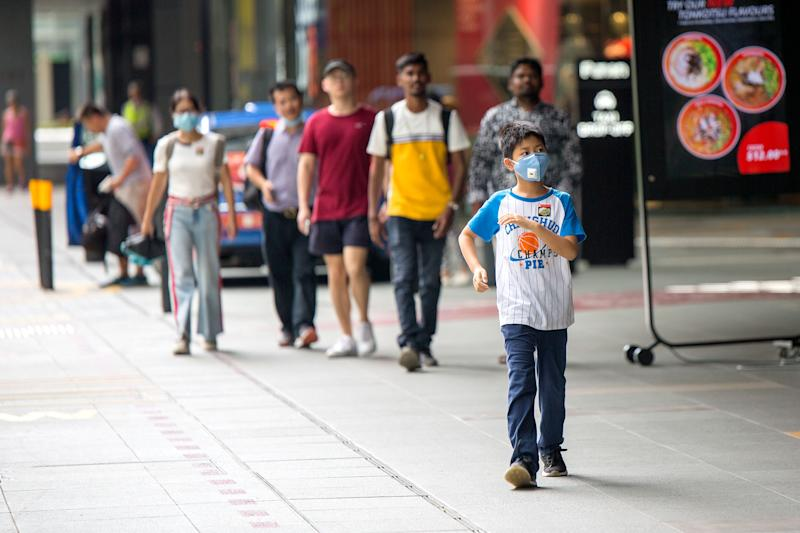A young boy seen wearing a face mask outside the Funan Mall. (PHOTO: Dhany Osman / Yahoo News Singapore)
