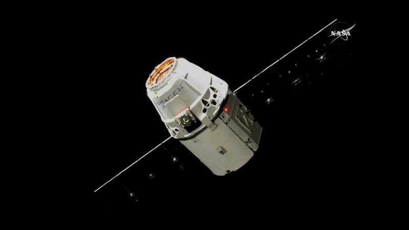 The SpaceX Dragon, pictured 30 meters from the International Space Station. Image courtesy: NASA TV
