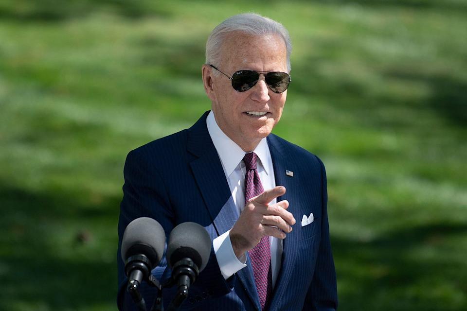 President Joe Biden speaks about updated guidelines on masks for people who are fully vaccinated during an event in front of the White House.