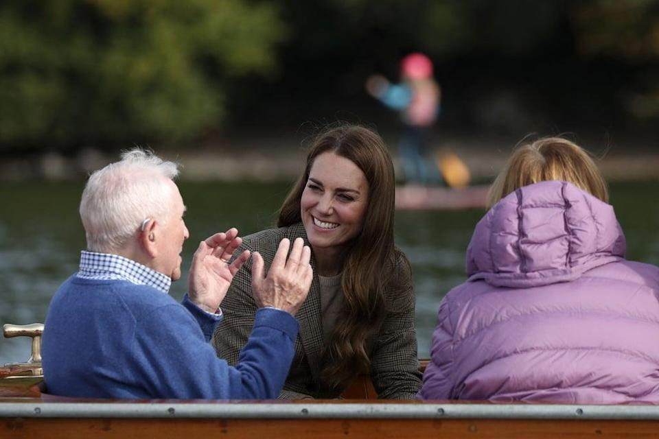 The Duchess of Cambridge (centre) meets Ike Alter and Diane Stoller in the steam launch Osprey (Scott Heppell/PA) (PA Wire)