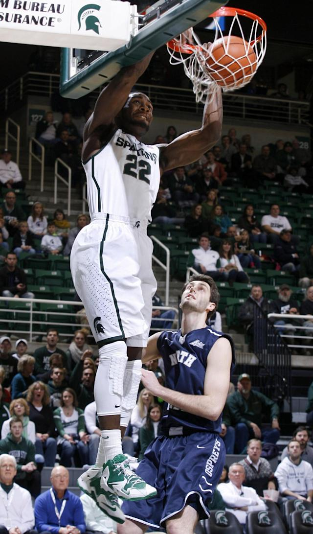 CORRECTS LOCATION TO EAST LANSING FROM AUBURN HILLS - Michigan State's Branden Dawson (22) dunks against North Florida's Beau Beech during the first half of an NCAA college basketball game, Tuesday, Dec. 17, 2013, in East Lansing, Mich. (AP Photo/Al Goldis)