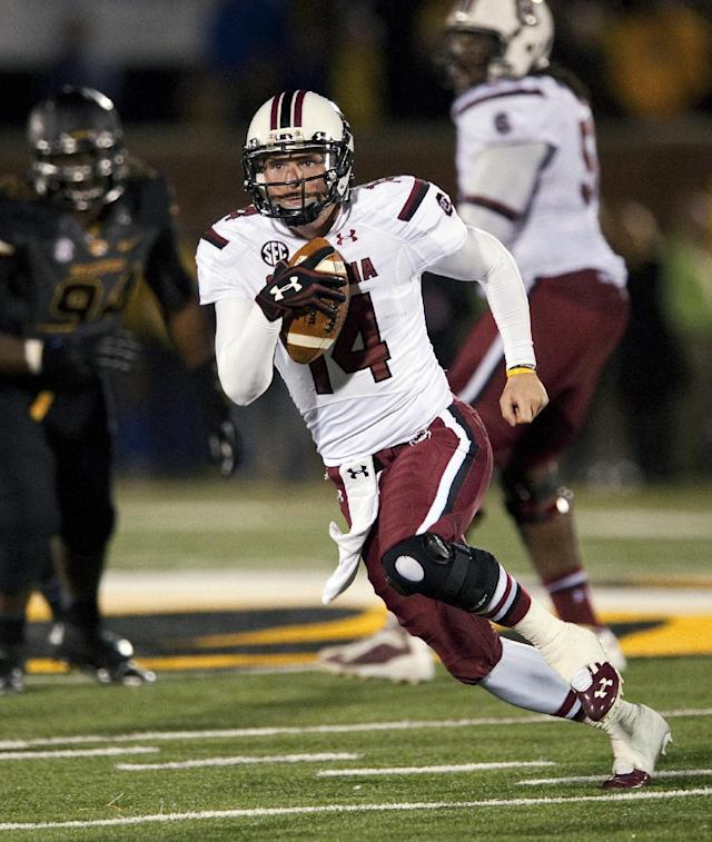 South Carolina quarterback Connor Shaw scrambles for yardage during the fourth quarter of an NCAA college football game against Missouri, Saturday, Oct. 26, 2013, in Columbia, Mo. South Carolina won 27-24. (AP Photo/L.G. Patterson)