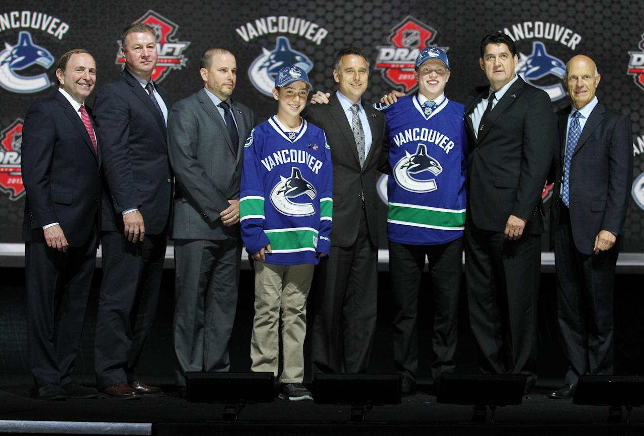 Jun 30, 2013; Newark, NJ, USA; Hunter Shinkaruk poses for a photo with team officials after being introduced as the number twenty-four overall pick to the Vancouver Canucks during the 2013 NHL Draft at the Prudential Center. (Ed Mulholland-USA TODAY Sports)