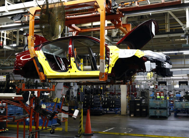 A 2019 Nissan Altima sedan is suspended on a conveyer belt at the Nissan Canton Vehicle Assembly Plant in Canton, Miss. The new NAFTA deal could see production in Canada decline and car prices go up, according to a government report. (AP Photo/Rogelio V. Solis)