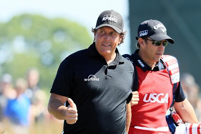 Five-time major golf champion Phil Mickelson apologized Wednesday for hitting a moving ball in Saturday's third round of the US Open Andrew Redington/Getty Images/AFP (AFP Photo/Andrew Redington)