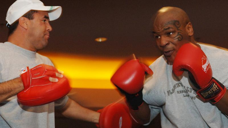 Jeff Fenech and Mike Tyson, pictured here at Planet Hollywood Resort and Casino in Las Vegas.