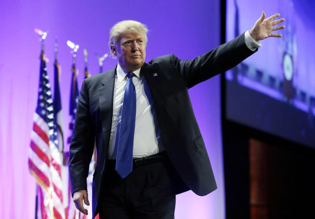 <p>Trump waves as he walks offstage after speaking at the Iowa Republican Party's Lincoln Dinner, May 16, 2015, in Des Moines. <i>(Photo: Charlie Neibergall/AP)</i> </p>
