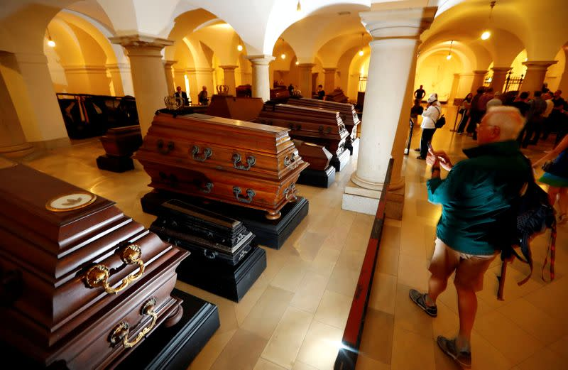 FILE PHOTO: Visitors walk beside coffins inside the crypt of the Prussian emperors - the Hohenzollern house - during a media tour to present the restoration plans of the area in the Berlin cathedral in Berlin