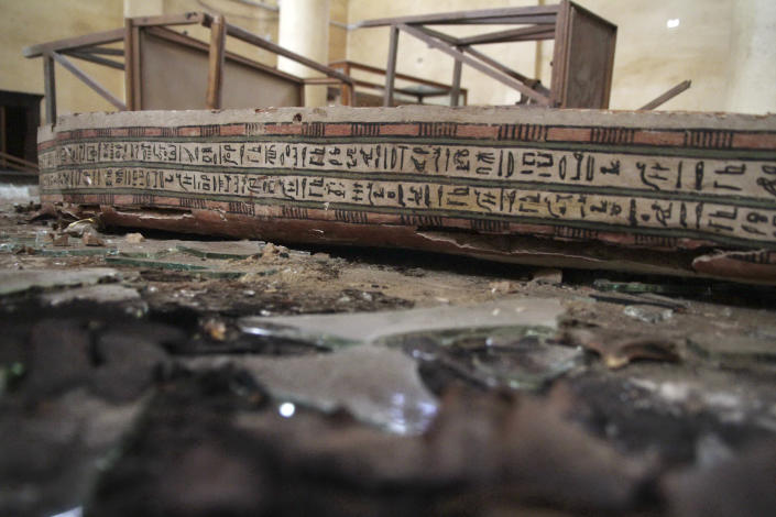 A damaged pharaonic object lies on the floor of the Malawi Antiquities Museum after it was ransacked and looted between the evening of Thursday, Aug. 15 and the morning of Friday, Aug. 16, 2013, in Malawi, south of Minya, Egypt, Saturday, Aug. 17, 2013. The interim Cabinet authorized police to use deadly force against anyone targeting police and state institutions on Thursday. The violence capped off a week that saw more than 700 people killed across the country. (AP Photo/Roger Anis, El Shorouk Newspaper) EGYPT OUT