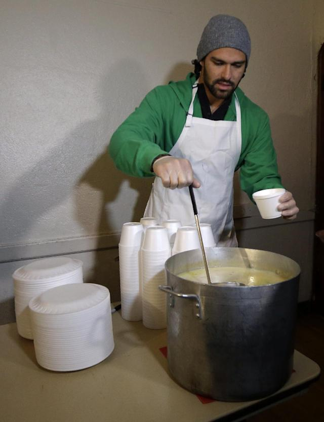 New York Jets NFL football quarterback Mark Sanchez pours a bowl of soup during a visit to the Community Soup Kitchen of Morristown as part of the team's Thanksgiving Day week celebration, Tuesday, Nov. 26, 2013, in Morristown, N.J. (AP Photo/Julio Cortez)