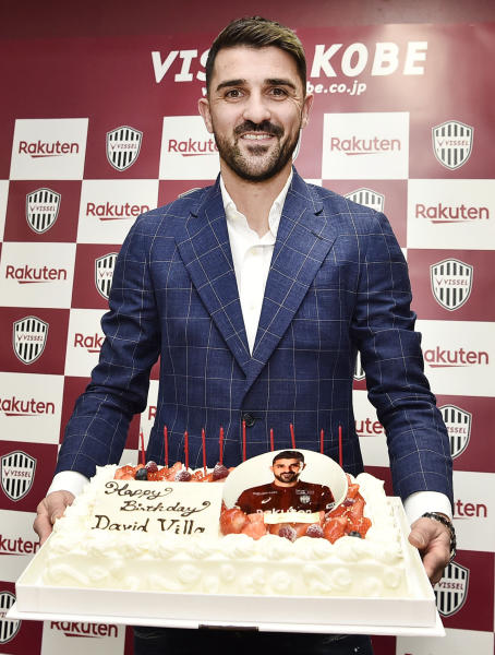 Former Spain international David Villa holds a birthday cake given to him from Vissel Kobe soccer club, in Kobe, western Japan, Saturday, Dec. 1, 2018. Villa will play for Vissel Kobe in the J1 League from the next season. His birthday is Dec. 3. (Junko Ozaki/Kyodo News via AP)