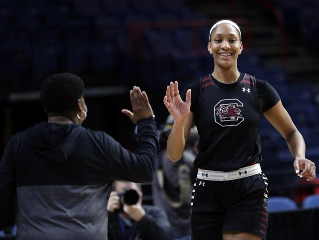 FILE - In this March 23, 2018 file photo South Carolina's A'ja Wilson (22) smiles during practice at the NCAA women's college basketball tournament in Albany, N.Y. Wilson is getting a statue at South Carolina. She helped South Carolina win the 2017 NCAA title and left as the school's all-time scoring leader. (AP Photo/Frank Franklin II)