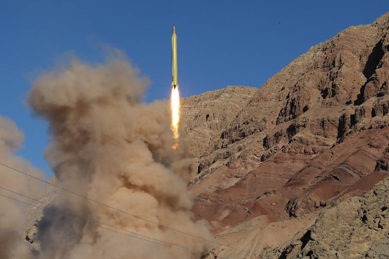 Iran launches a medium-range Qadr ballistic missile in the Alborz mountains on March 9, 2016