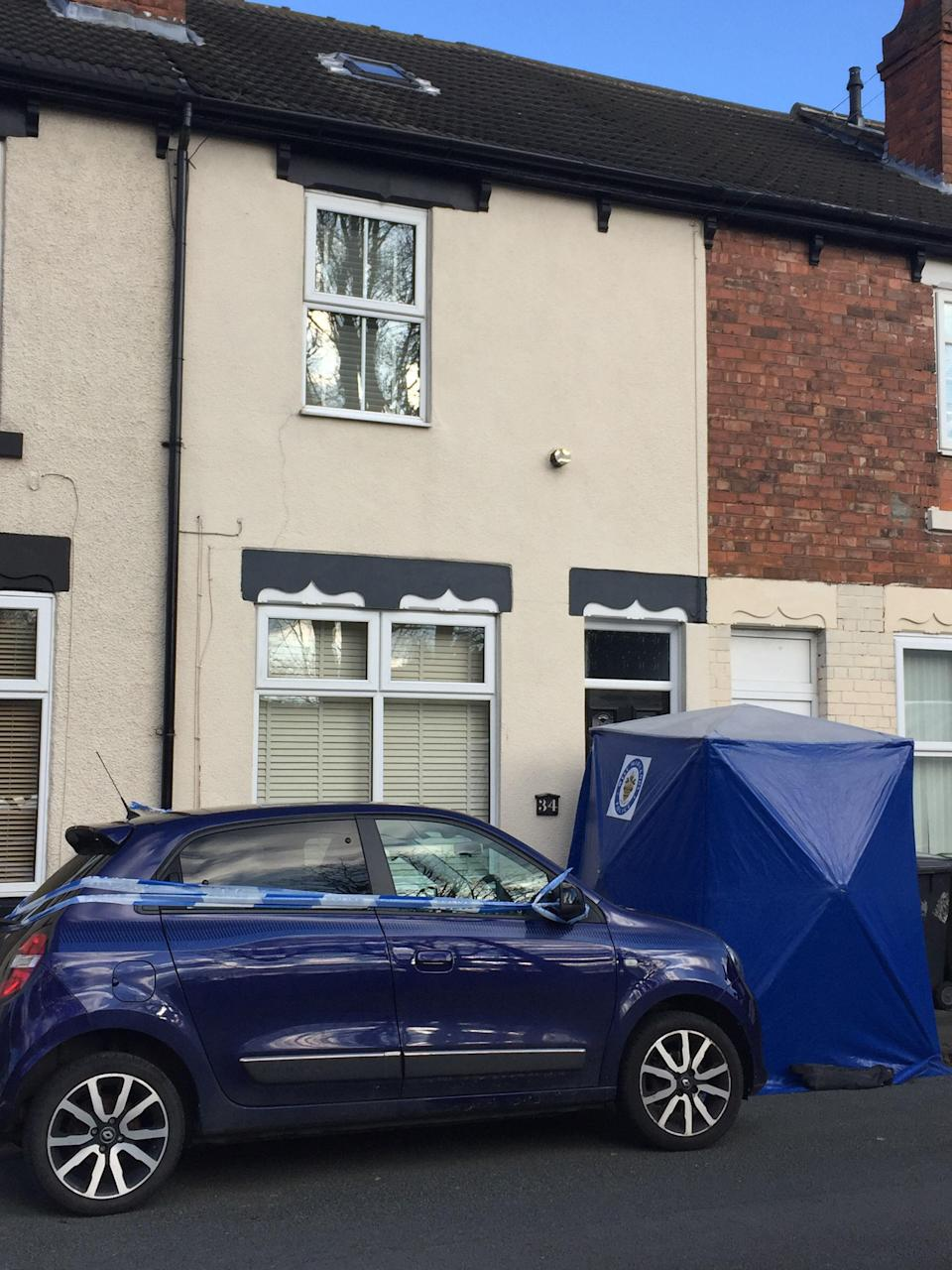 A police corden in place at the scene in James Street, Bilston, Wolverhampton, after a woman's body was found at her home. A 40-year-old man has been arrested on suspicion of murder