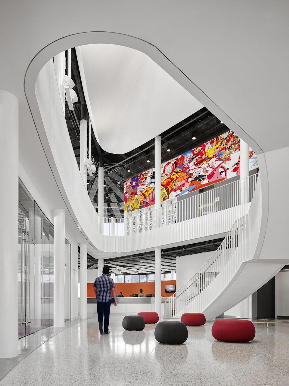"""<p>Chicago Public Library's Chinatown branch is an <a href=""""http://www.chipublib.org/locations/20/"""" rel=""""nofollow noopener"""" target=""""_blank"""" data-ylk=""""slk:otherworldly structure"""" class=""""link rapid-noclick-resp"""">otherworldly structure</a> inspired by its neighborhood. Its design is based on Feng Shui principles, and its glass exterior is meant to evoke a glowing lantern at night. The building also won a <a href=""""http://www.aia.org/practicing/awards/AIAB083450"""" rel=""""nofollow noopener"""" target=""""_blank"""" data-ylk=""""slk:AIA/ALA Library Building Award"""" class=""""link rapid-noclick-resp"""">AIA/ALA Library Building Award</a> earlier this year. </p>"""