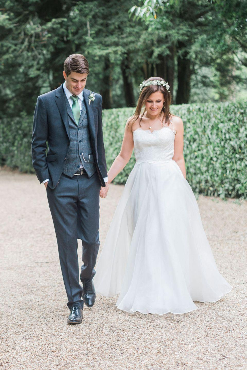 <p><strong>Wedding dress</strong>: Watters Brides</p><p><strong>Shoes</strong>: Anthropologie</p><p><strong>Floral headpiece</strong>: Bright Blooms Floral Boutique</p>