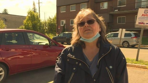 Sonja Reiss says she's worried she won't be able to move back into her apartment building in Dollard-des-Ormeaux for several days. It was evacuated Wednesday night after firefighters found it to be structurally unsound.  (CBC - image credit)
