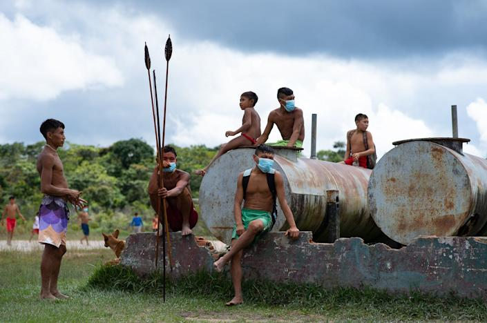"""<span class=""""caption"""">Yanomami Indigenous Brazilians wait to receive health care from missionaries in Roraima state, July 1, 2020.</span> <span class=""""attribution""""><a class=""""link rapid-noclick-resp"""" href=""""https://www.gettyimages.com/detail/news-photo/yanomami-indigenous-wait-to-receive-health-care-during-the-news-photo/1223854141?adppopup=true"""" rel=""""nofollow noopener"""" target=""""_blank"""" data-ylk=""""slk:Andressa Anholete / Getty Images"""">Andressa Anholete / Getty Images</a></span>"""