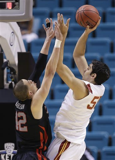 USC's Omar Oraby (55) shoots against Utah's Jason Washburn (42) in the first half during a Pac-12 tournament NCAA college basketball game on Wednesday, March 13, 2013, in Las Vegas. (AP Photo/Julie Jacobson)