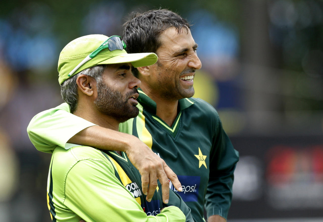 Pakistan Younis Khan, right, interacts with coach Waqar Younis during a practice session ahead in Mohali, India, Monday, March 28, 2011. Pakistan will play India in a Cricket World Cup semifinal in Mohali on March 30.