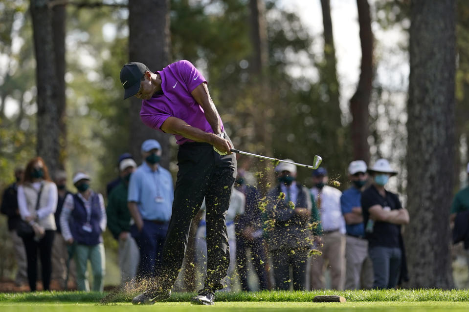Tiger Woods tees off on the fourth hole during the third round of the Masters golf tournament Saturday, Nov. 14, 2020, in Augusta, Ga. (AP Photo/David J. Phillip)