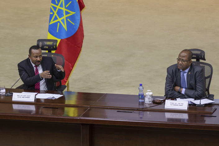 """Ethiopia's Prime Minister Abiy Ahmed, left, responds to questions from members of parliament, accompanied by Speaker of the Ethiopian House of Peoples Representatives Tagesse Chafo, right, at the prime minister's office in the capital Addis Ababa, Ethiopia Monday, Nov. 30, 2020. The fugitive leader of Ethiopia's defiant Tigray region on Monday called on Prime Minister Abiy Ahmed to withdraw troops from the region as he asserted that fighting continues """"on every front"""" two days after Abiy declared victory. (AP Photo/Mulugeta Ayene)"""