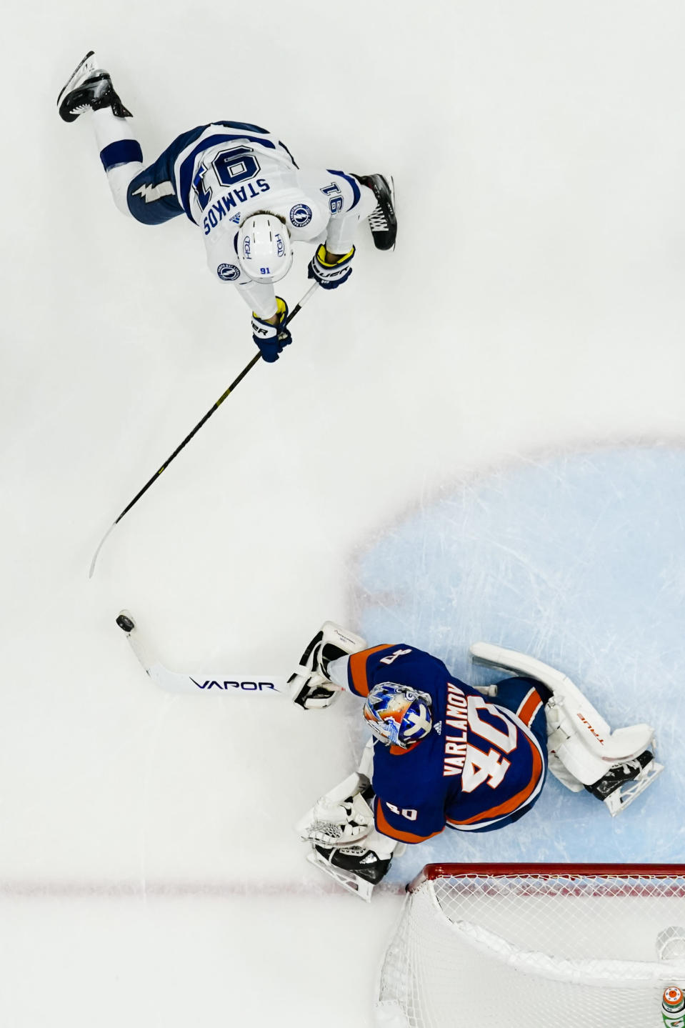 New York Islanders goaltender Semyon Varlamov (40) stops a shot on goal by Tampa Bay Lightning's Steven Stamkos (91) during the first period of Game 6 of an NHL hockey semifinals Wednesday, June 23, 2021, in Uniondale, N.Y. The Islanders won 3-2. (AP Photo/Frank Franklin II)