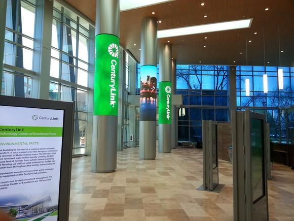 Lobby with pillars that have CenturyLink logo on them.