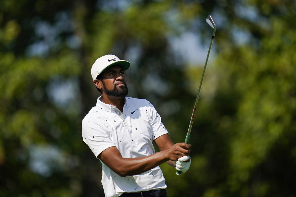 Tony Finau tees off on the 13th hole during the ProAm at the BMW Championship golf tournament, Wednesday, Aug. 25, 2021, at Caves Valley Golf Club in Owings Mills, Md. The BMW Championship tournament begins Thursday. (AP Photo/Julio Cortez)