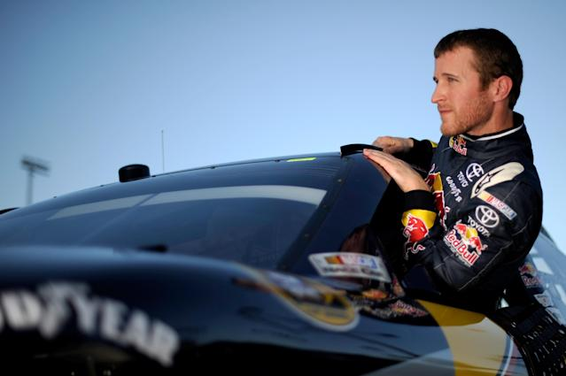 HOMESTEAD, FL - NOVEMBER 19: Kasey Kahne, driver of the #4 Red Bull Toyota, climbs out of his car after qualifying for the NASCAR Sprint Cup Series Ford 400 at Homestead-Miami Speedway on November 19, 2011 in Homestead, Florida. (Photo by Jared C. Tilton/Getty Images)