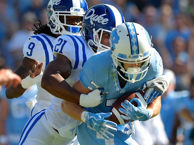 "CHAPEL HILL, NC – SEPTEMBER 23: Alonzo Saxton II #21 of the <a class=""link rapid-noclick-resp"" href=""/ncaab/teams/dau/"" data-ylk=""slk:Duke Blue Devils"">Duke Blue Devils</a> tackles <a class=""link rapid-noclick-resp"" href=""/ncaaf/players/239298/"" data-ylk=""slk:Austin Proehl"">Austin Proehl</a> #7 of the <a class=""link rapid-noclick-resp"" href=""/ncaab/teams/nav/"" data-ylk=""slk:North Carolina Tar Heels"">North Carolina Tar Heels</a> during their game at Kenan Stadium on September 23, 2017 in Chapel Hill, North Carolina. (Photo by Grant Halverson/Getty Images)"