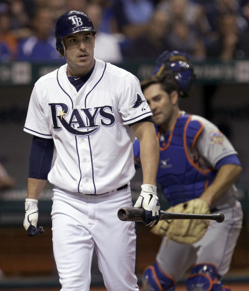 Tampa Bay Rays' Matt Joyce heads back to the dugout after striking out against New York Mets starting pitcher R.A. Dickey during the fourth inning of an interleague baseball game Wednesday, June 13, 2012, in St. Petersburg, Fla. Catching for the Mets is Mike Nickeas. (AP Photo/Chris O'Meara)