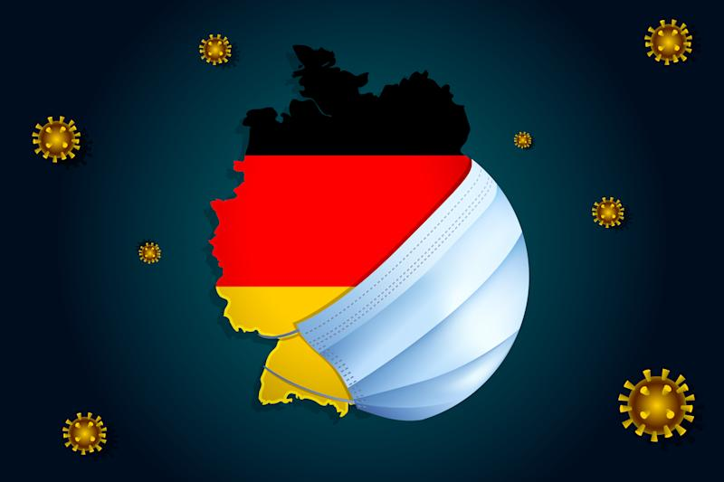 Coronavirus or Corona virus concept. Map with flag of Germany on background in a medical mask protects itself from nCoV. Viruses Around Germany.