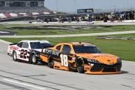 Daniel Hemric (18) leads Austin Cindric (22) into Turn 1 during a NASCAR Xfinity Series auto race at Texas Motor Speedway in Fort Worth, Texas, Saturday, June 12, 2021. (AP Photo/Larry Papke)