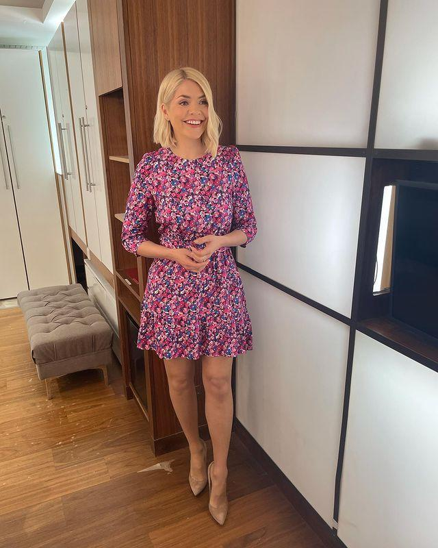 """<p>Spotted on Holly recently is this gorgeous floral pink mini dress, who posted a picture of her summery outfit to Instagram, ahead of her This Morning presenting job. </p><p><a href=""""https://www.instagram.com/p/COM-4pChPLU/"""" rel=""""nofollow noopener"""" target=""""_blank"""" data-ylk=""""slk:See the original post on Instagram"""" class=""""link rapid-noclick-resp"""">See the original post on Instagram</a></p>"""