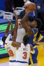 Golden State Warriors center James Wiseman, right, shoots over New York Knicks guard Alec Burks (18) and center Nerlens Noel (3) during the first half of an NBA basketball game in San Francisco, Thursday, Jan. 21, 2021. (AP Photo/Jeff Chiu)
