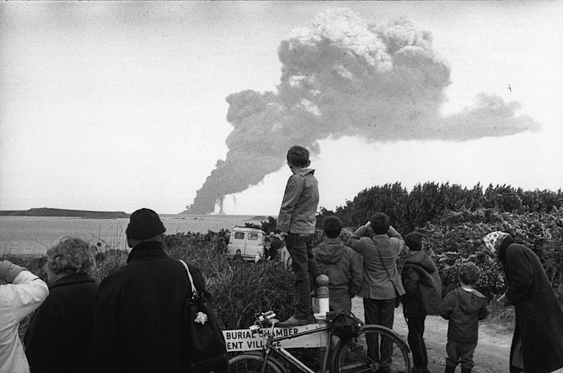 People at Land's End, Cornwall watch the bombing of the stricken tanker (Getty)