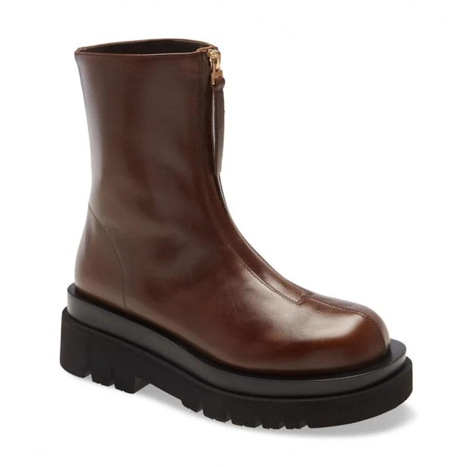 """It's official: Brown is the new black, and these zip-up boots are a great way to make a foray into the chocolate-toned trend. $205, Nordstrom. <a href=""""https://www.nordstrom.com/s/jeffrey-campbell-dozed-platform-bootie/5699695"""" rel=""""nofollow noopener"""" target=""""_blank"""" data-ylk=""""slk:Get it now!"""" class=""""link rapid-noclick-resp"""">Get it now!</a>"""