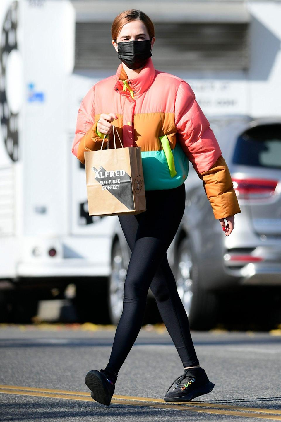 <p>Zoey Deutch bundles up in the colors of the rainbow for a coffee run in Los Angeles on Friday.</p>