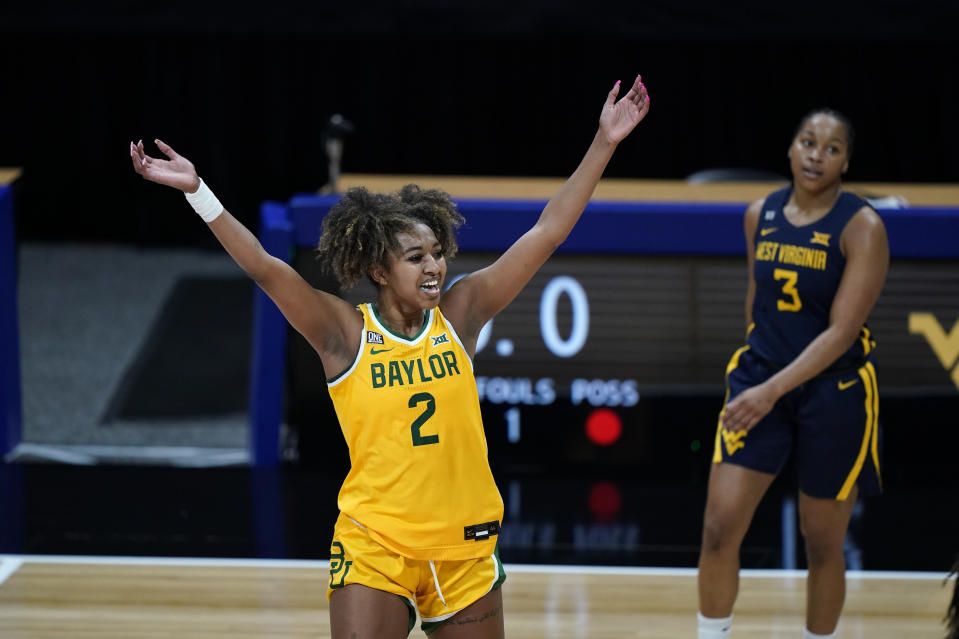 Baylor's DiDi Richards celebrates a basket during the first half of an NCAA college basketball game against West Virginia in the final round of the Big 12 Conference tournament in Kansas City, Mo, Sunday, March 14, 2021. (AP Photo/Charlie Riedel)
