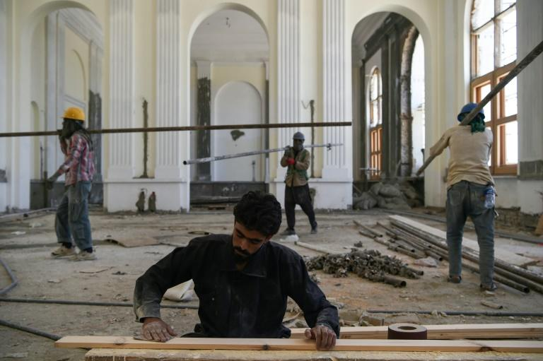 Project manager Javid Hammad said reconstructing Darulaman Palace is vital to Afghanistan, as the work promises a new beginning after so much conflict (AFP Photo/WAKIL KOHSAR)