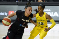 Las Vegas Aces guard Kayla McBride, left, drives around Seattle Storm guard Jordin Canada during the first half of Game 1 of basketball's WNBA Finals Friday, Oct. 2, 2020, in Bradenton, Fla. (AP Photo/Chris O'Meara)