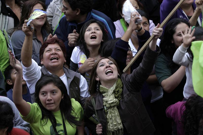 Supporters of Ecuador's President and candidate for re-election Rafael Correa gather to celebrate after presidential elections in Quito, Ecuador, Sunday, Feb. 17, 2013. Although official results had still not been released, Correa celebrated his second re-election as Ecuador's president after an exit poll showed him leading by a wide margin. (AP Photo/Dolores Ochoa)